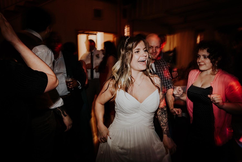 bride has fun at her wedding