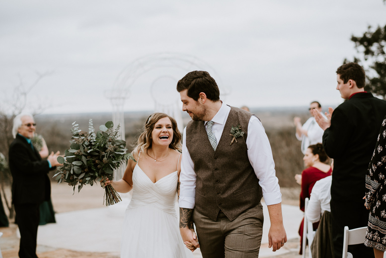 bride and groom walk down the aisle after wedding ceremony
