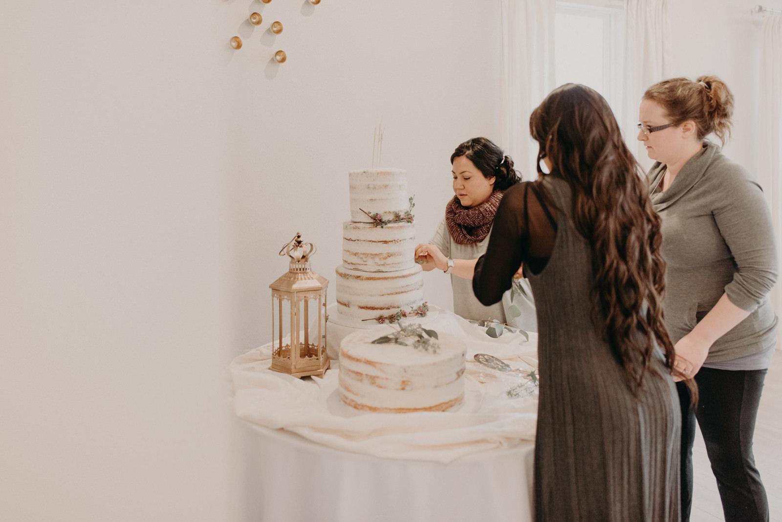 wedding cake being decorated