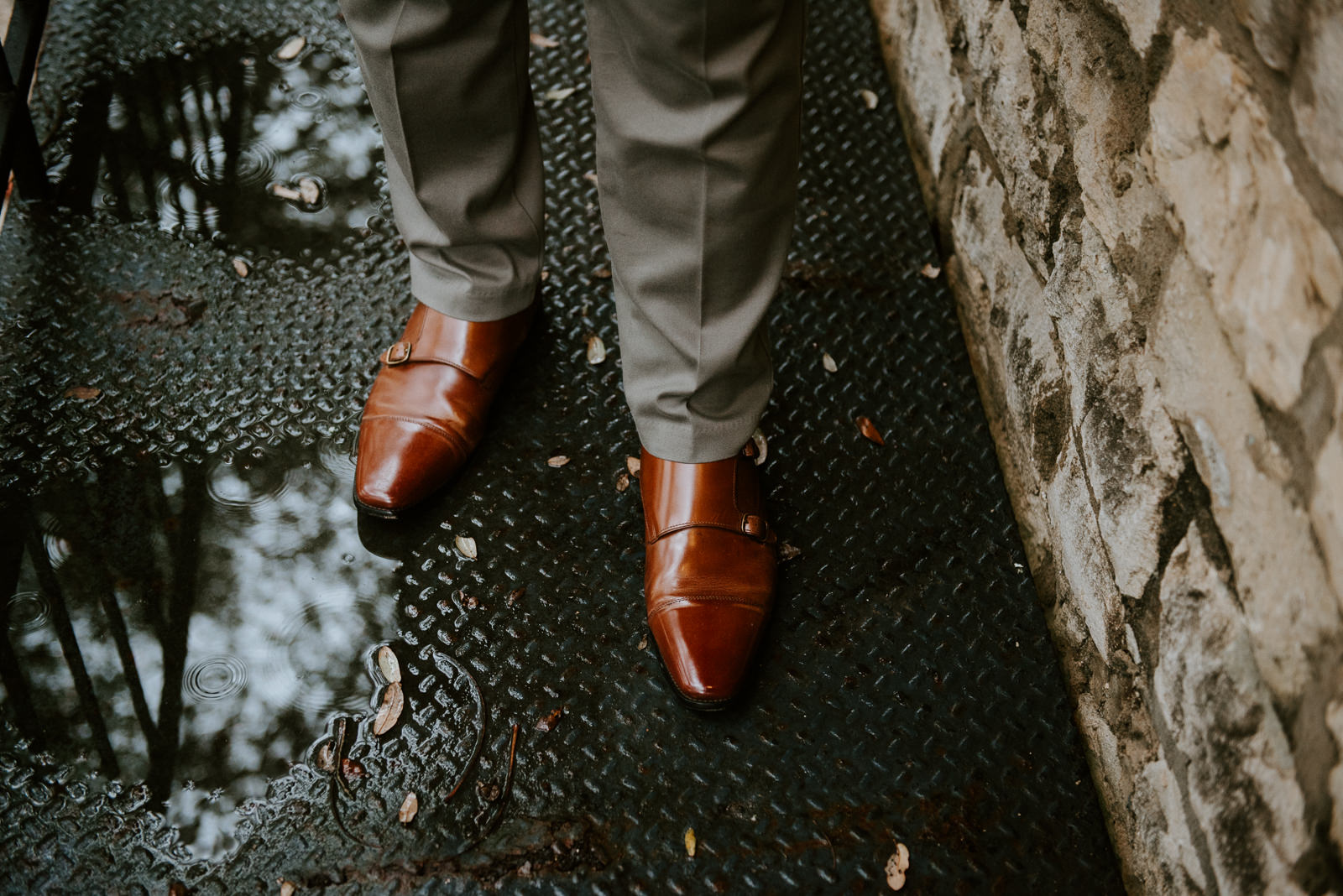 grooms shoes at rainy day wedding