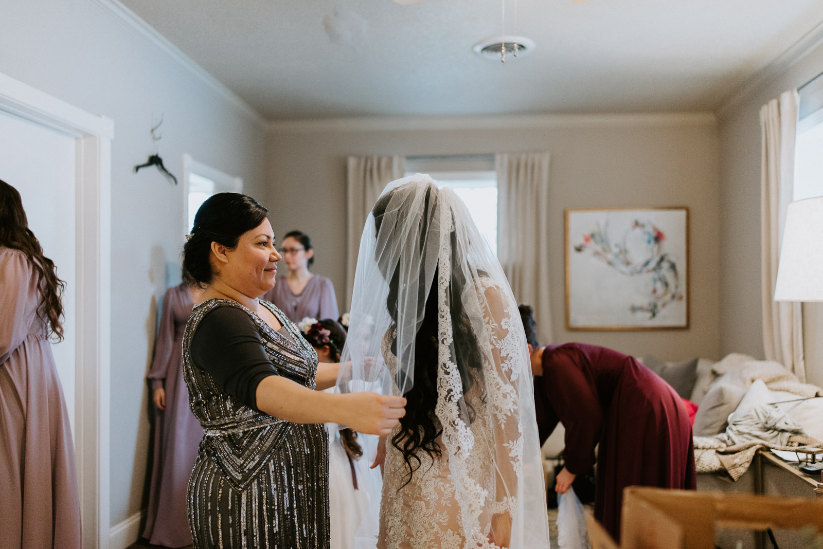 mother helps bride get ready at texas wedding