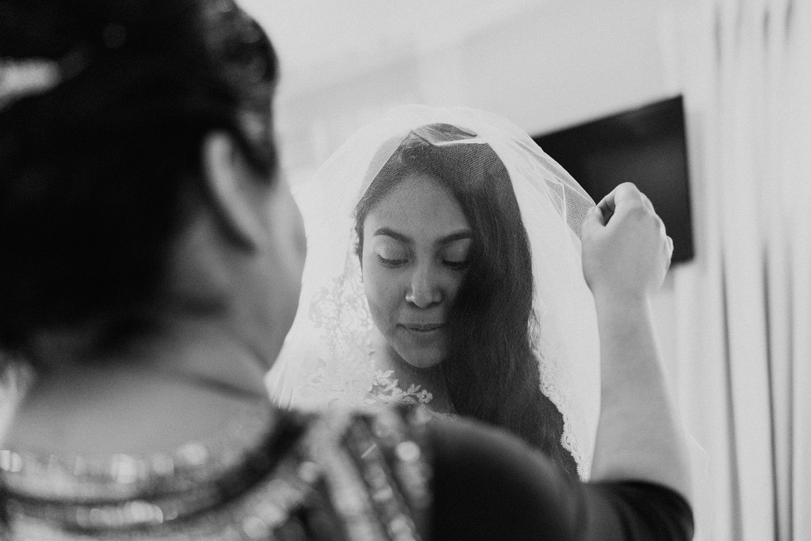 mother helps bride with veil at stonehouse villa wedding