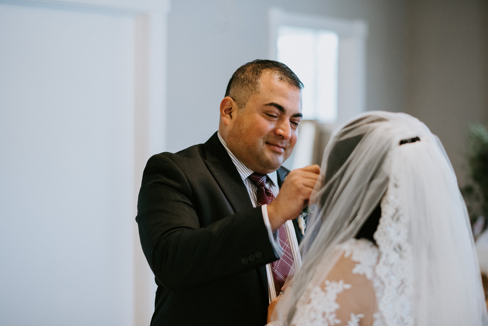 first look between father and bride