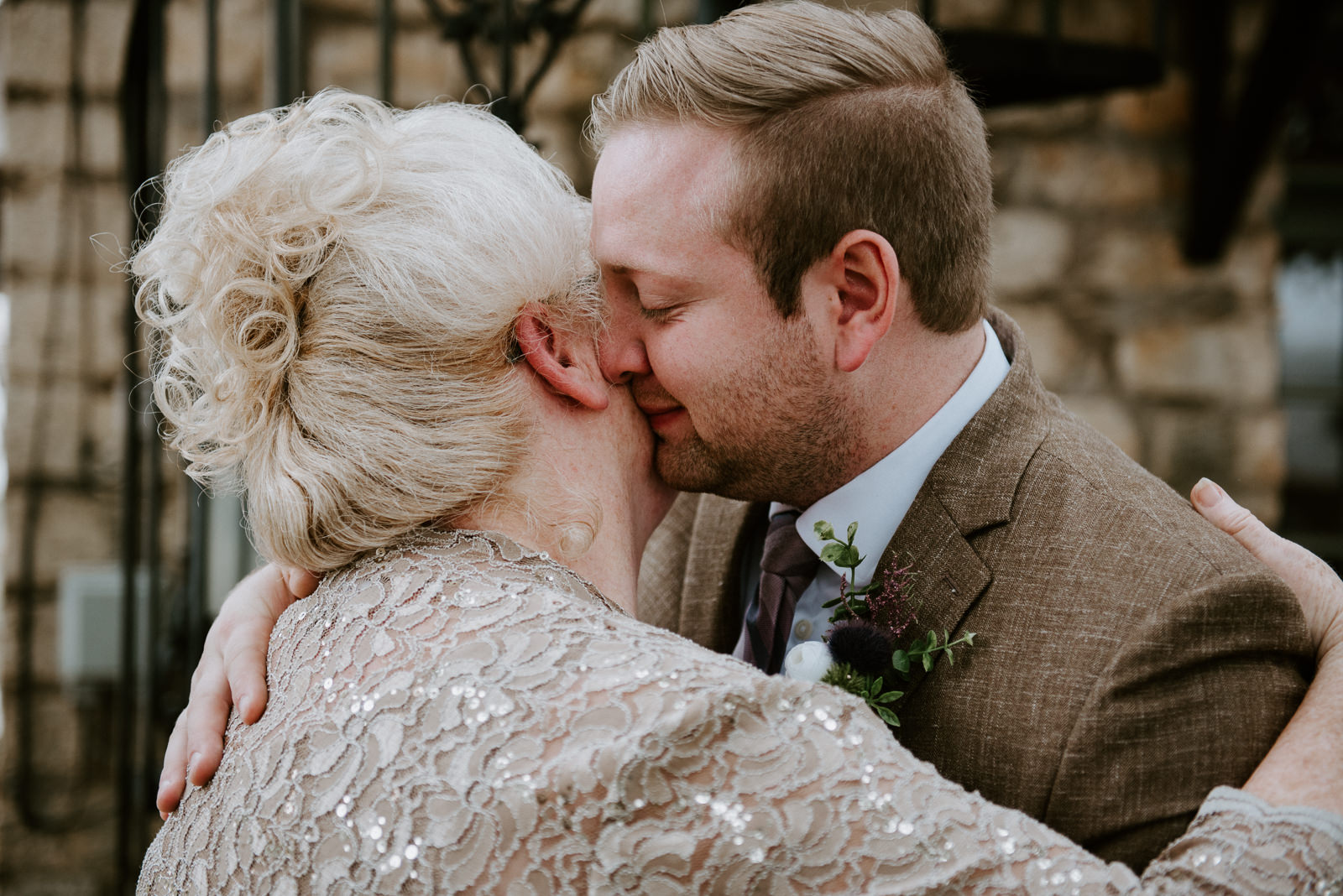 groom and mother share a moment befoe stonehouse villa wedding