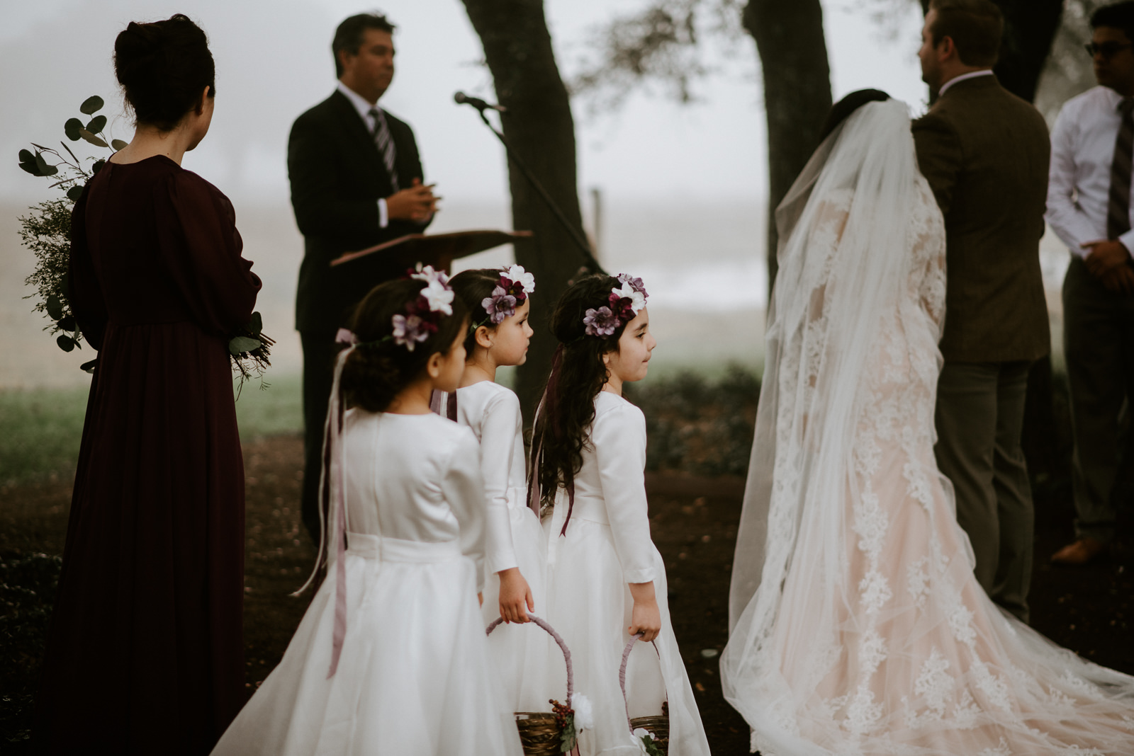 flower girls stand at the altar at austin texas wedding