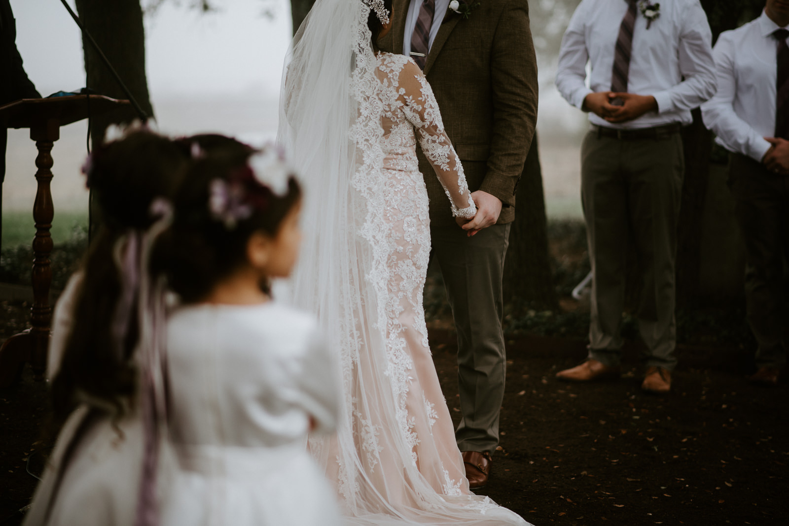 bride and groom holds at wedding ceremony