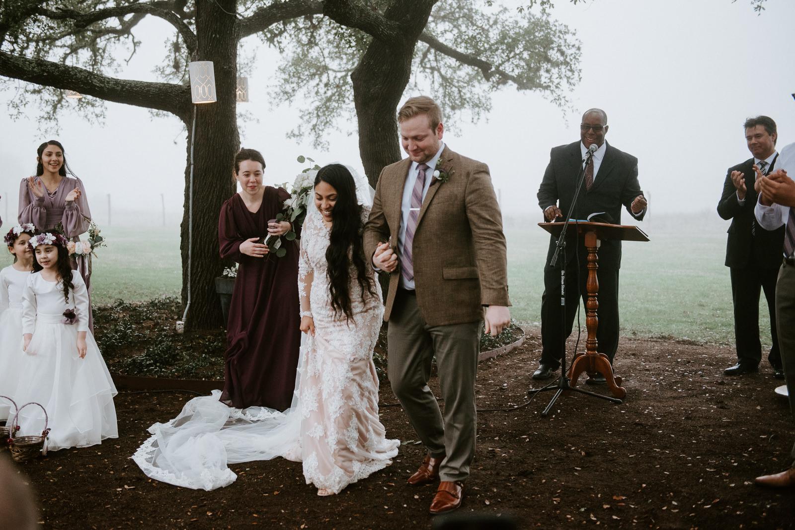 bride and groom exit at austin wedding