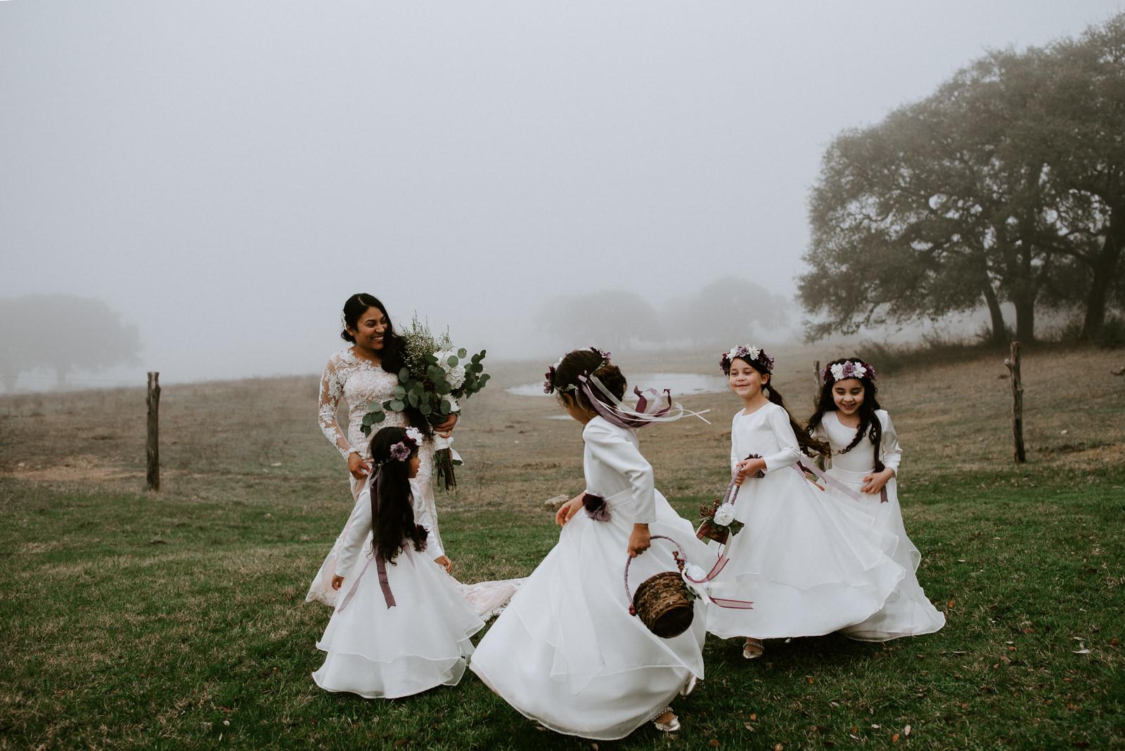 bride and flower girls dancing