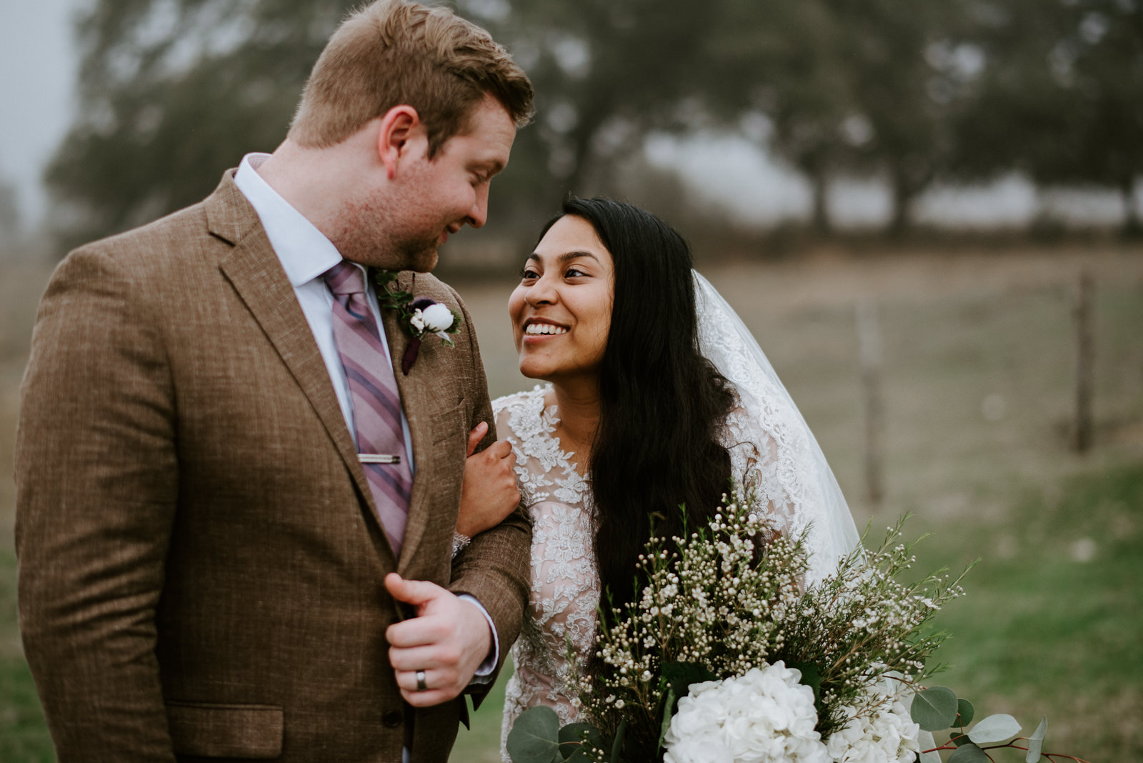 bride and groom at foggy wedding texas hill country