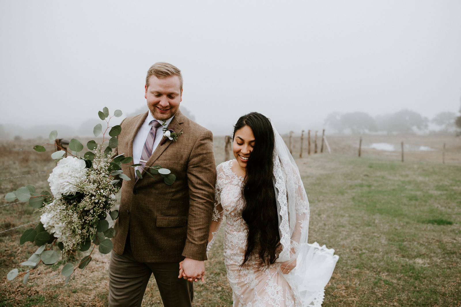 bride and groom walk at texas hill country wedding