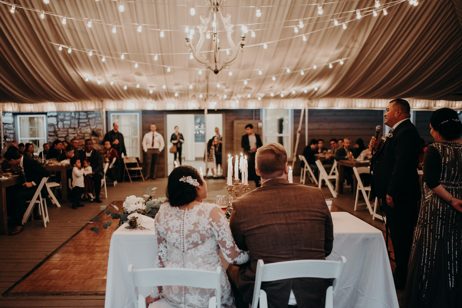 bride and groom during speeches at stonehouse villa
