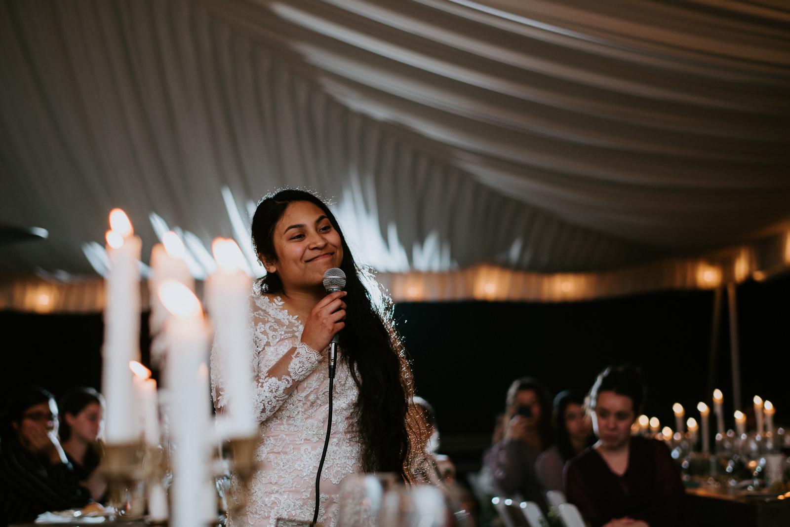 bride sings to groom at wedding