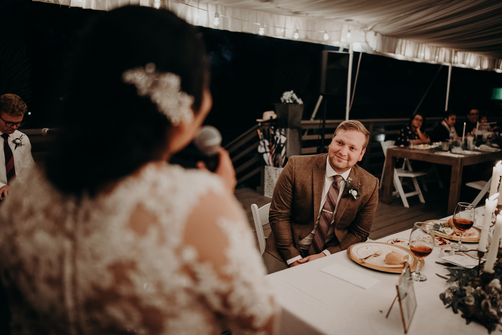 groom watches bride sing to him at their wedding in austin