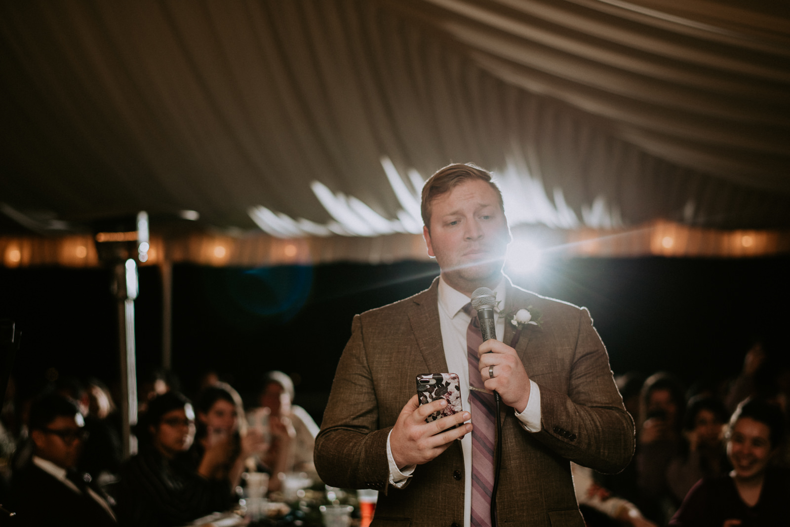 groom sings to his bride at their stonehouse villa wedding