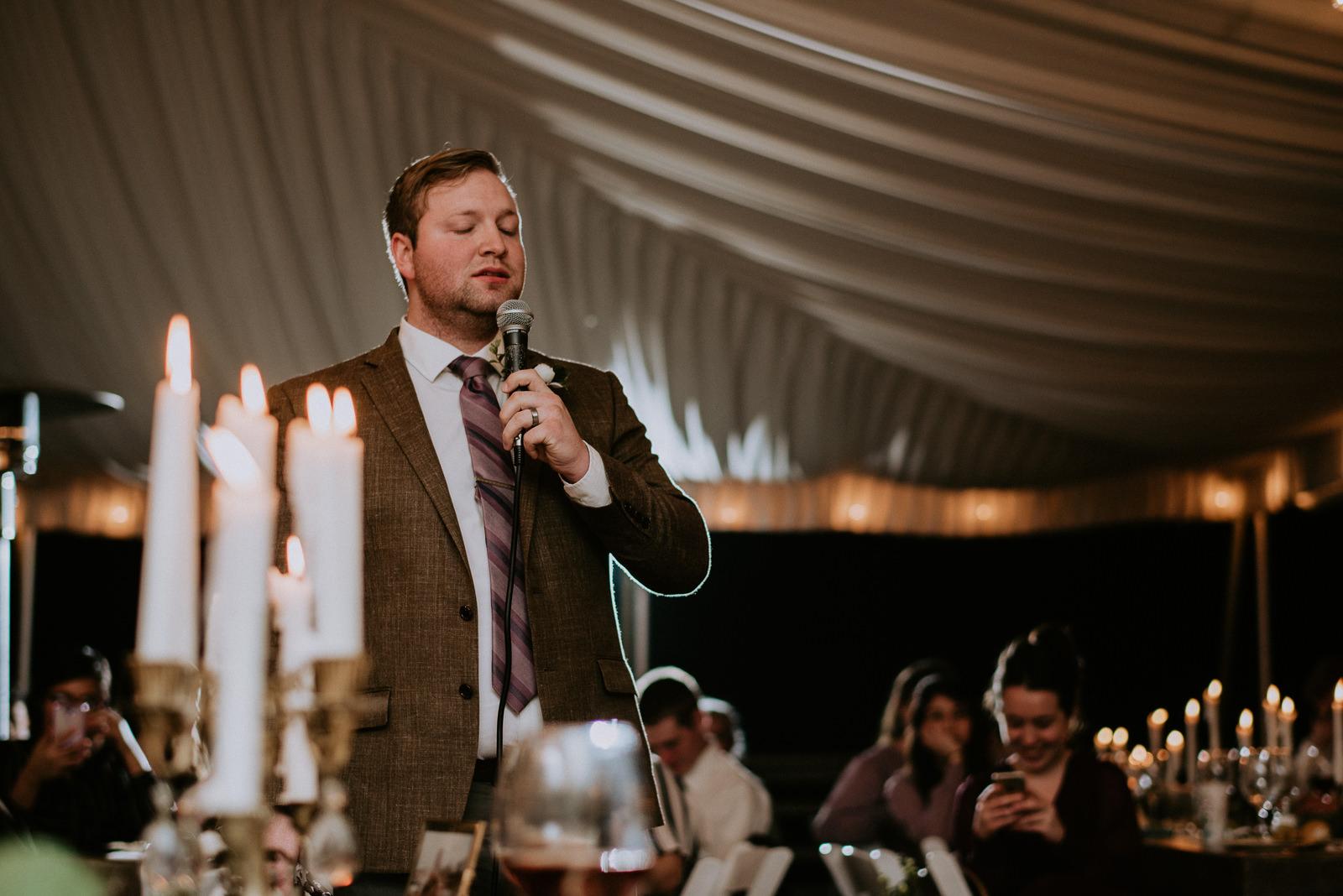 groom sings a song at wedding