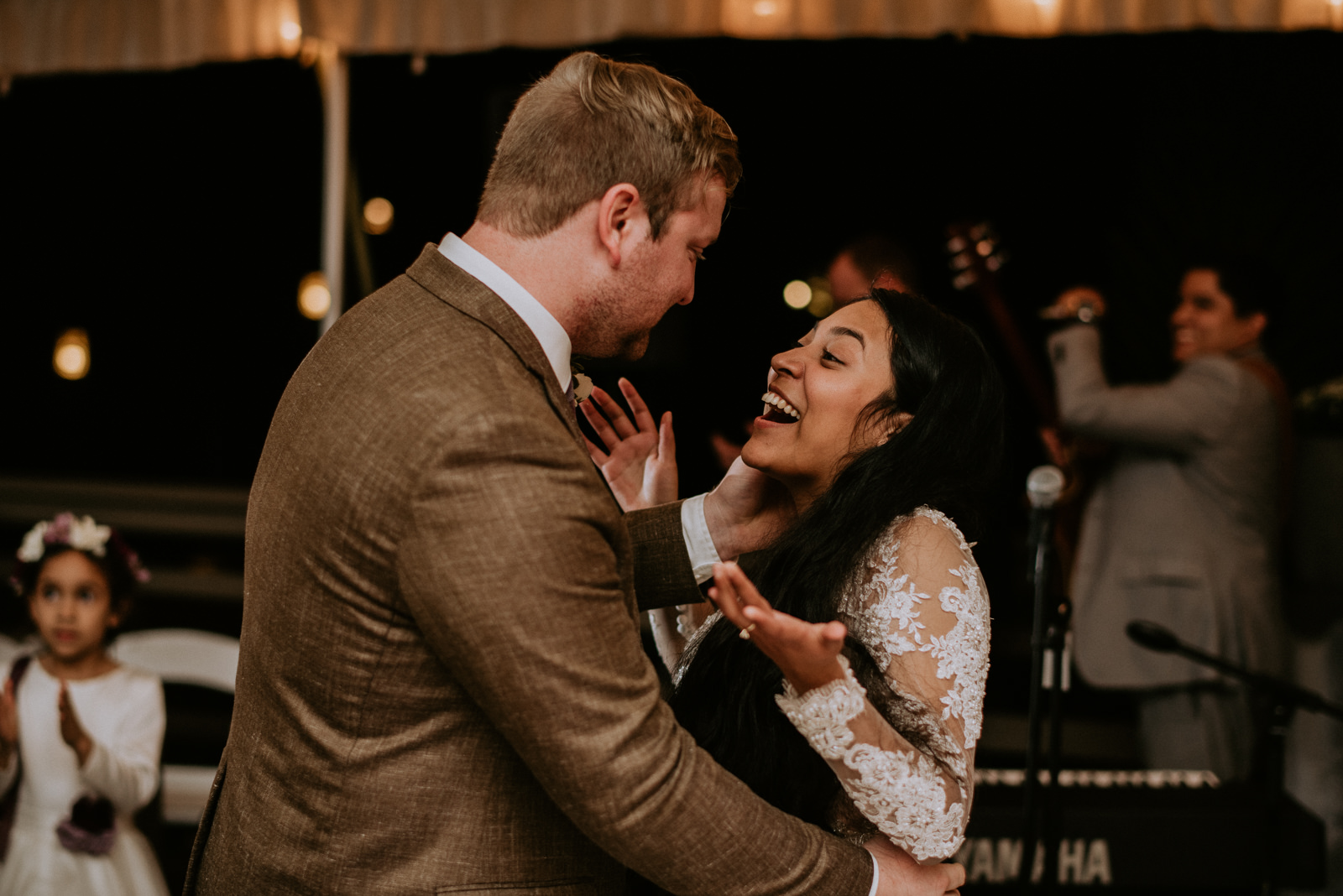 bride reacts to groom singing her a song