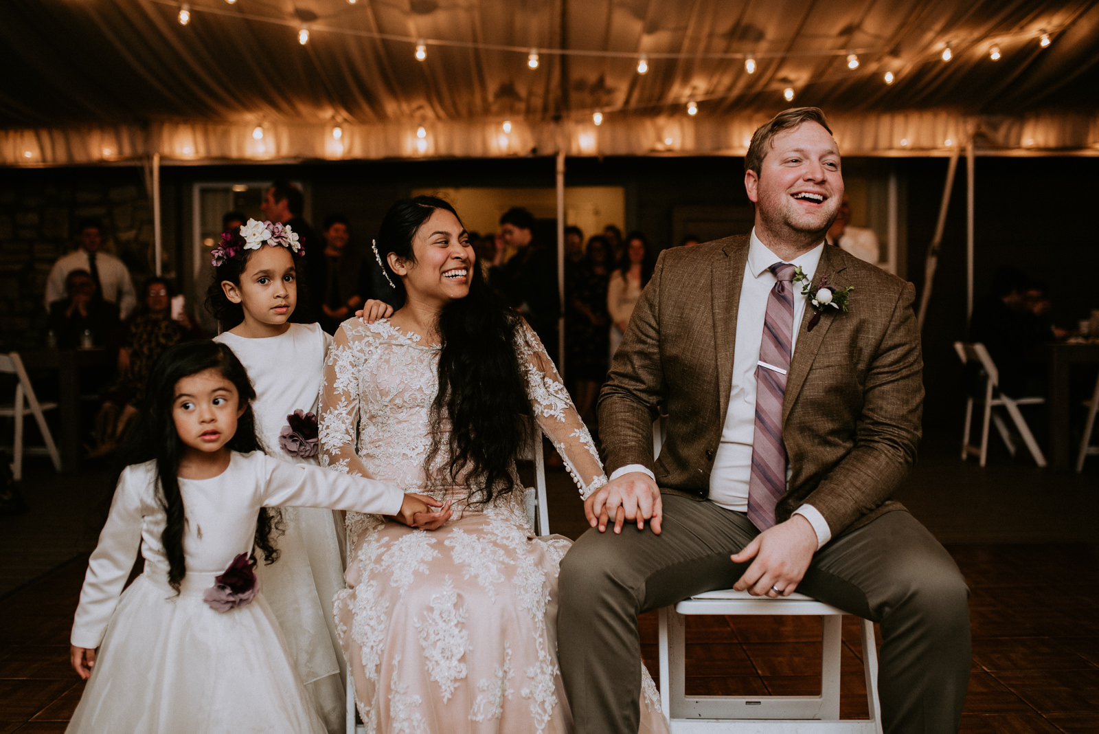 bride and groom react to funny song at austin wedding