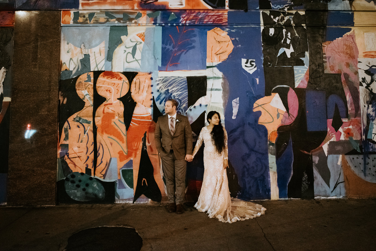 bride and groom portraits with austin street art