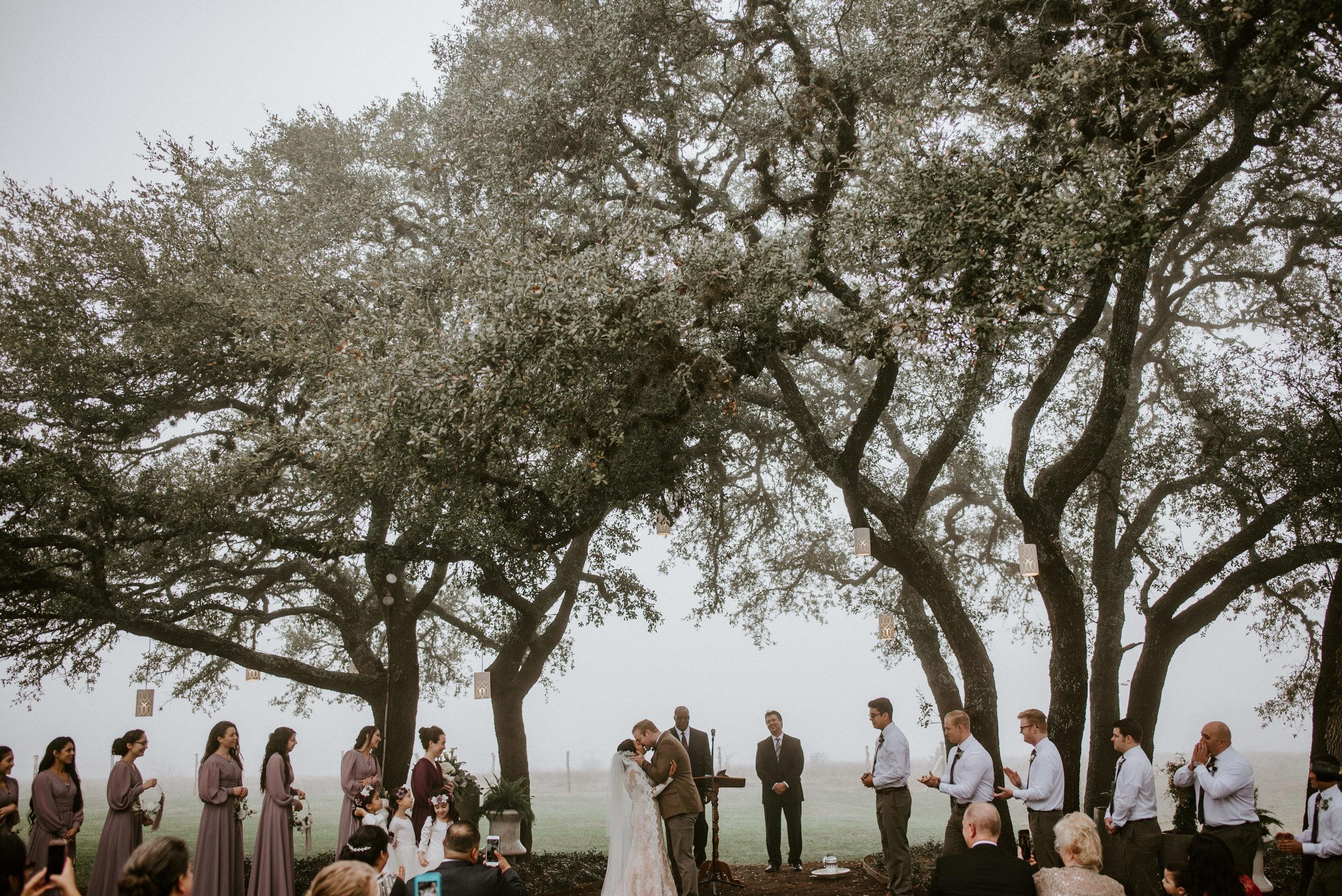 first kiss at stonehouse villa wedding in driftwood texas
