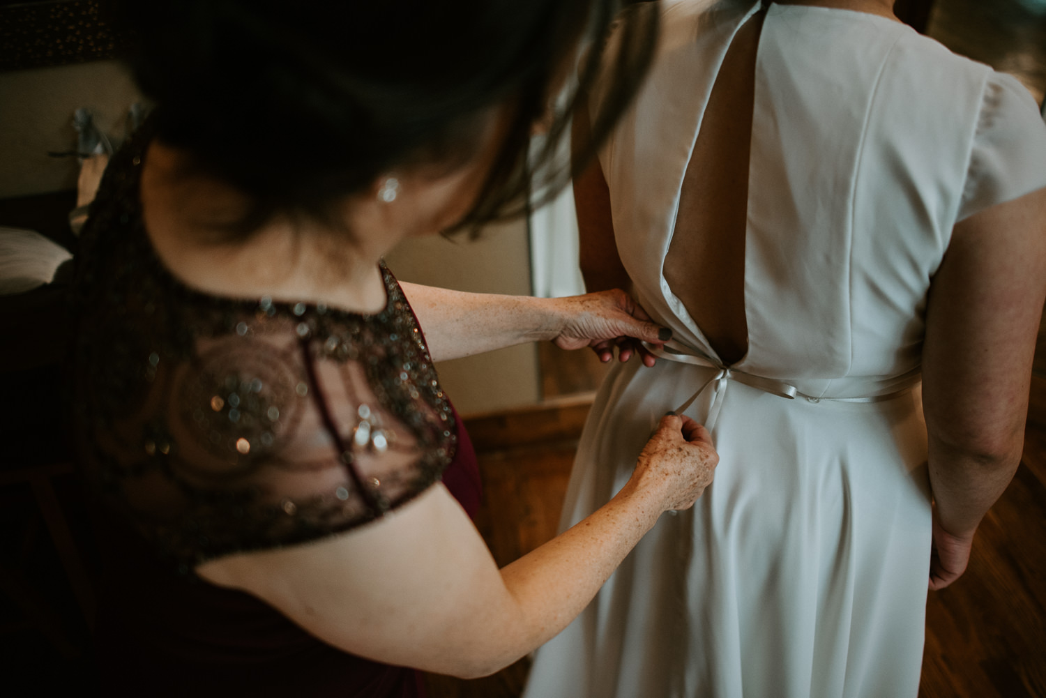 bride prepares for her wedding at the springs event venue