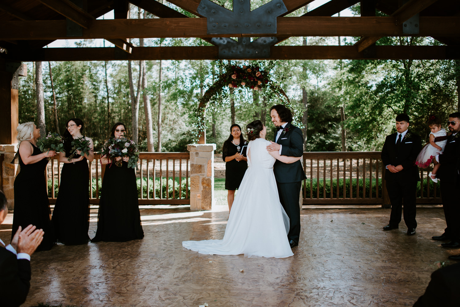 bride and groom first kiss at houston wedding