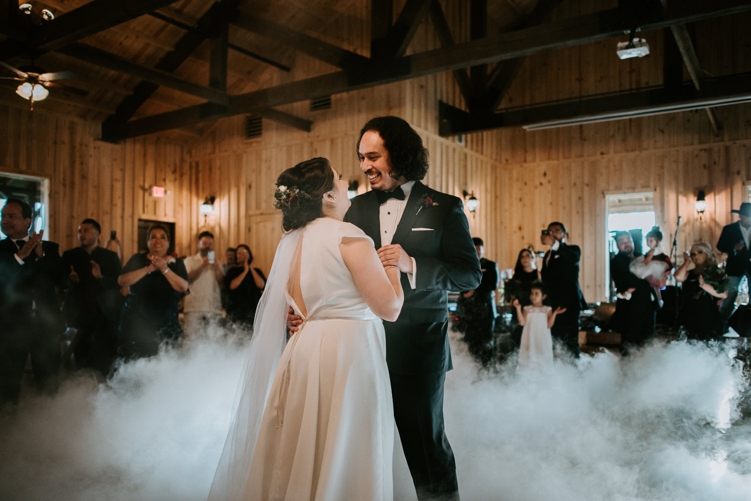 bride and groom first dance with smoke