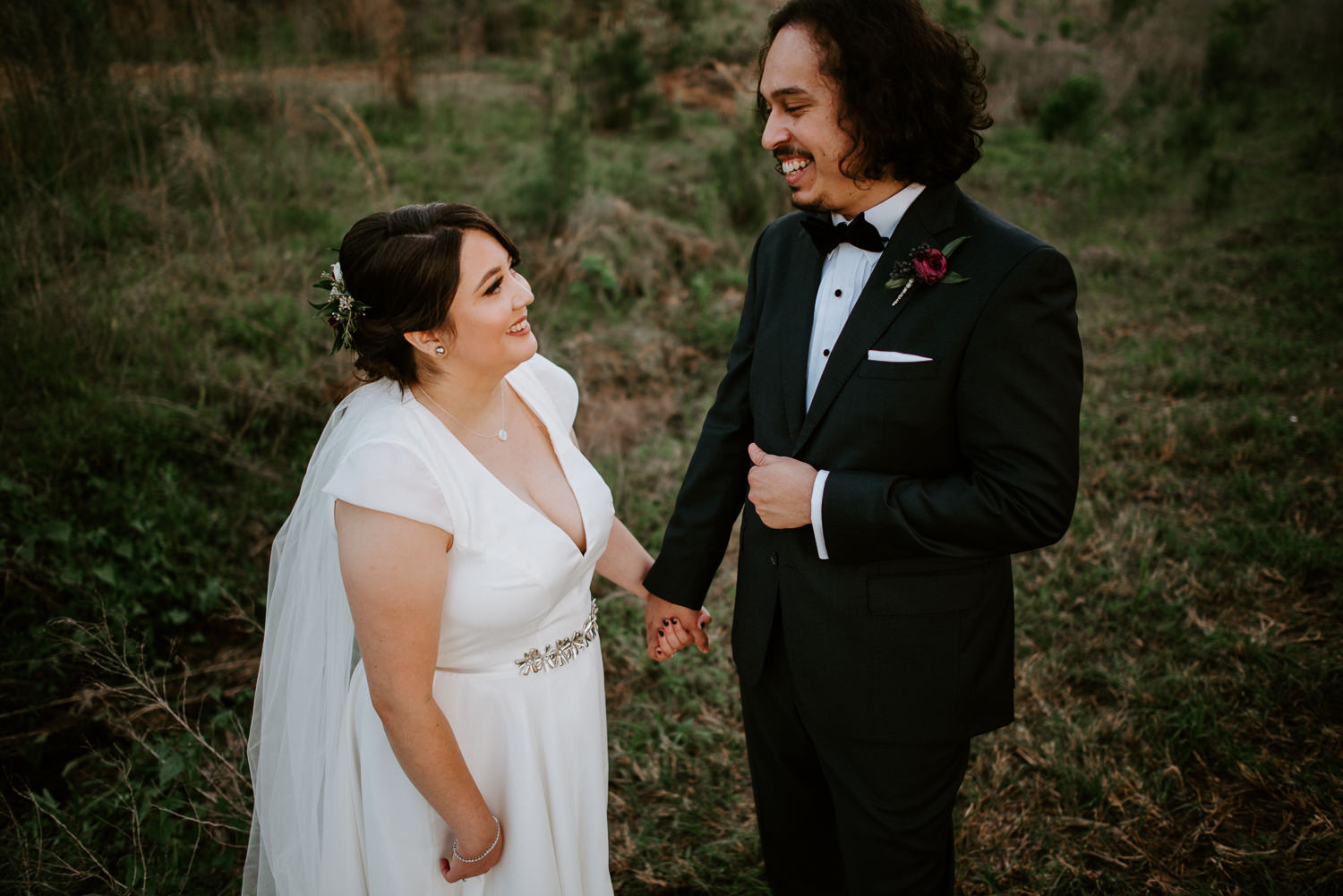 bride and groom laugh together at The Woodlands wedding