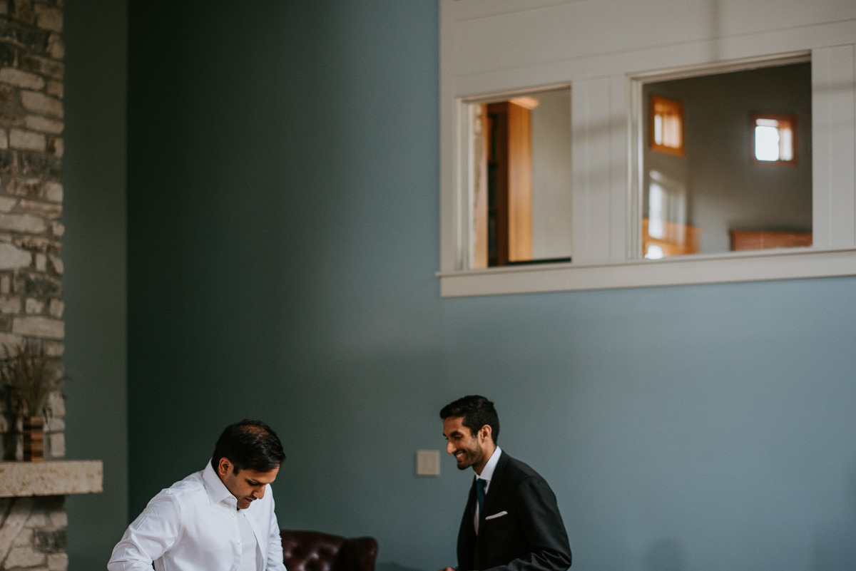 groom and brother get ready before wedding