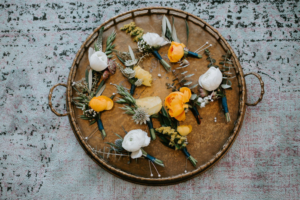 yellow and white boutonniere display at texas wedding