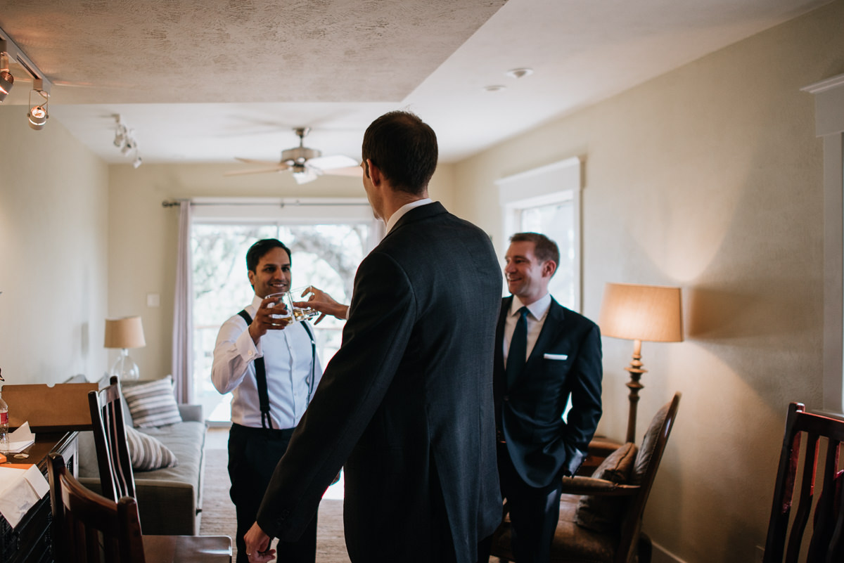 groom and friends toast before wedding