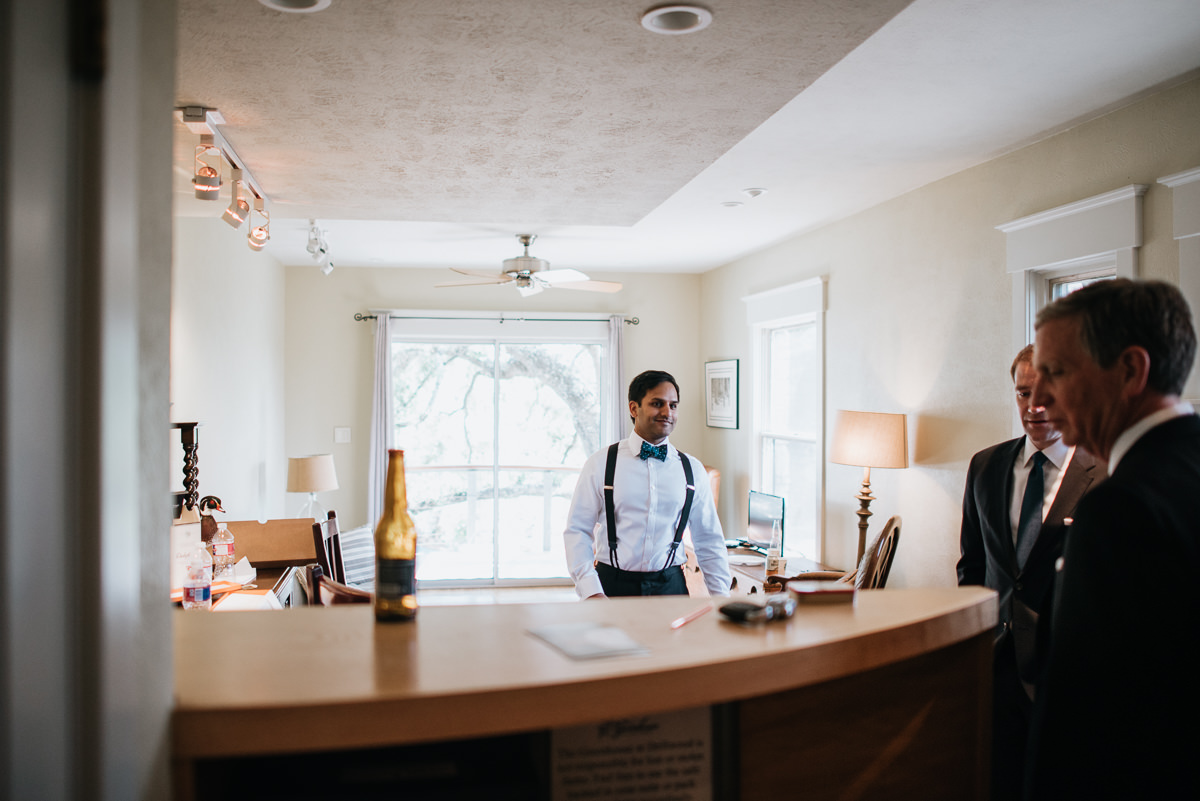 groom gets ready for his wedding in austin texas