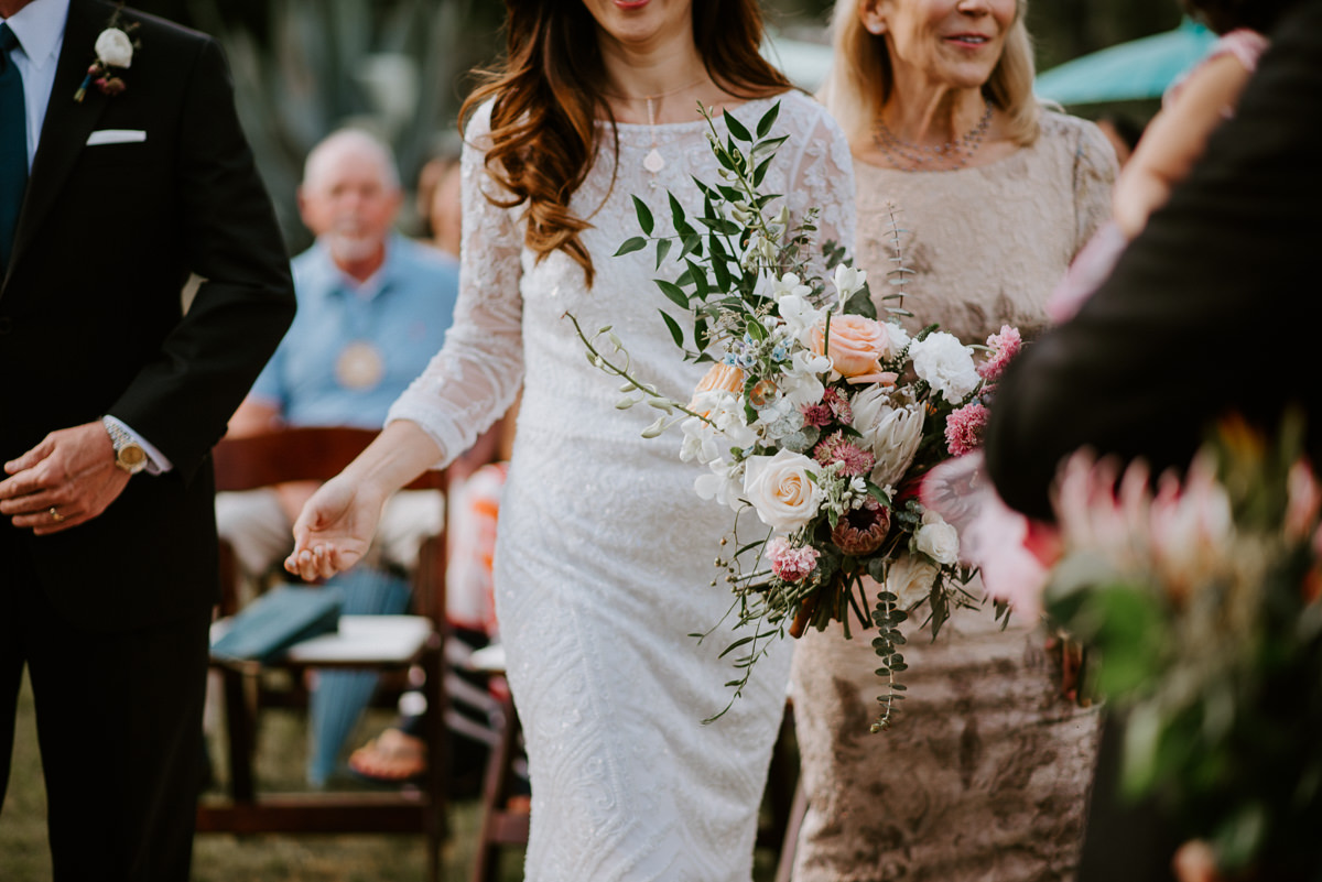 bride and her bouquet from gypsy floral