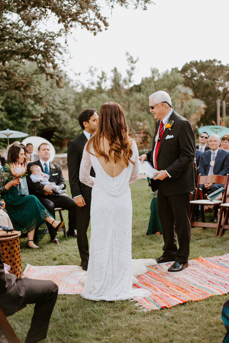 bride and groom at the altar of texas hill country wedding