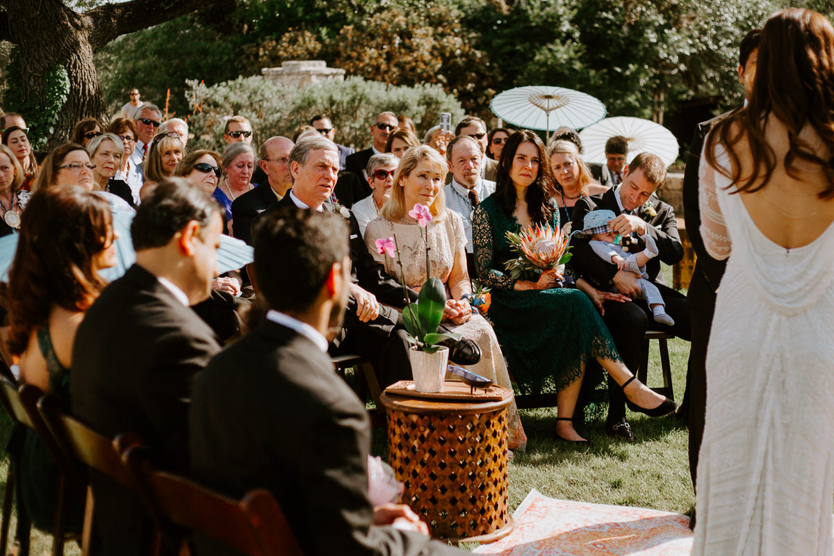 guest watch wedding ceremony at the greenhouse at driftwood