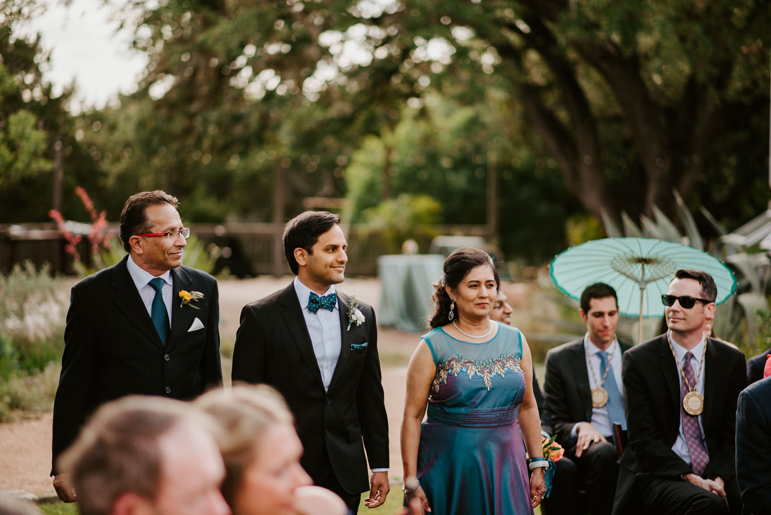groom walks down the aisle at the greenhouse at driftwood wedding