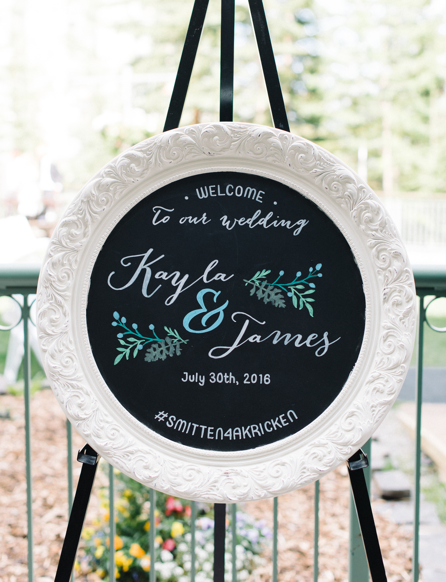 Here Kayla & James have included their names as well as hashtag on their wedding welcome sign.Photo courtesy of Sarah Vaughan