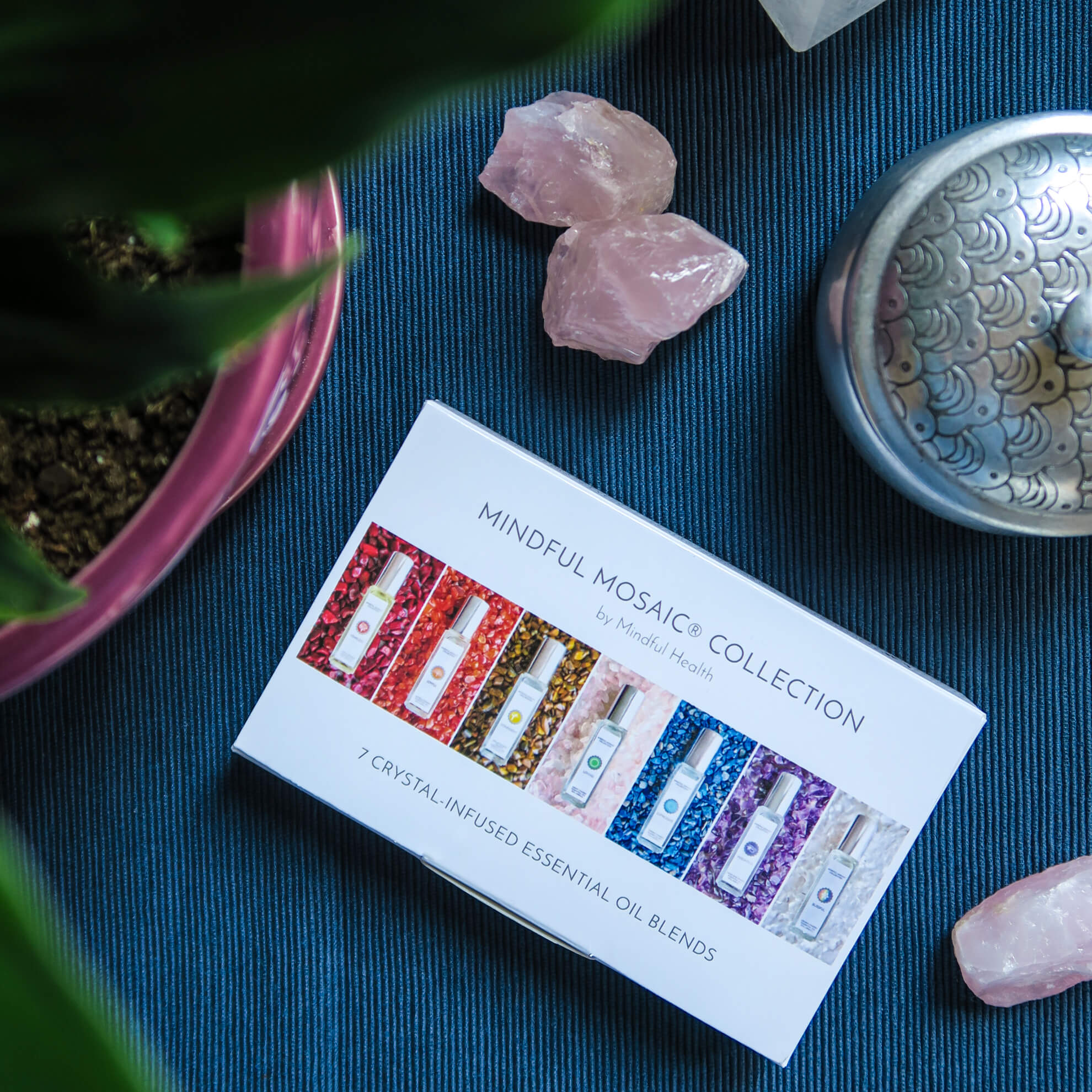 Mindful Mosaic 7-Chakra Gem Infused Essential Oil Kit:  Enjoy the healing benefits of these gem-infused essential oils. Perfect for daily use, travel or even during a spa treatment.