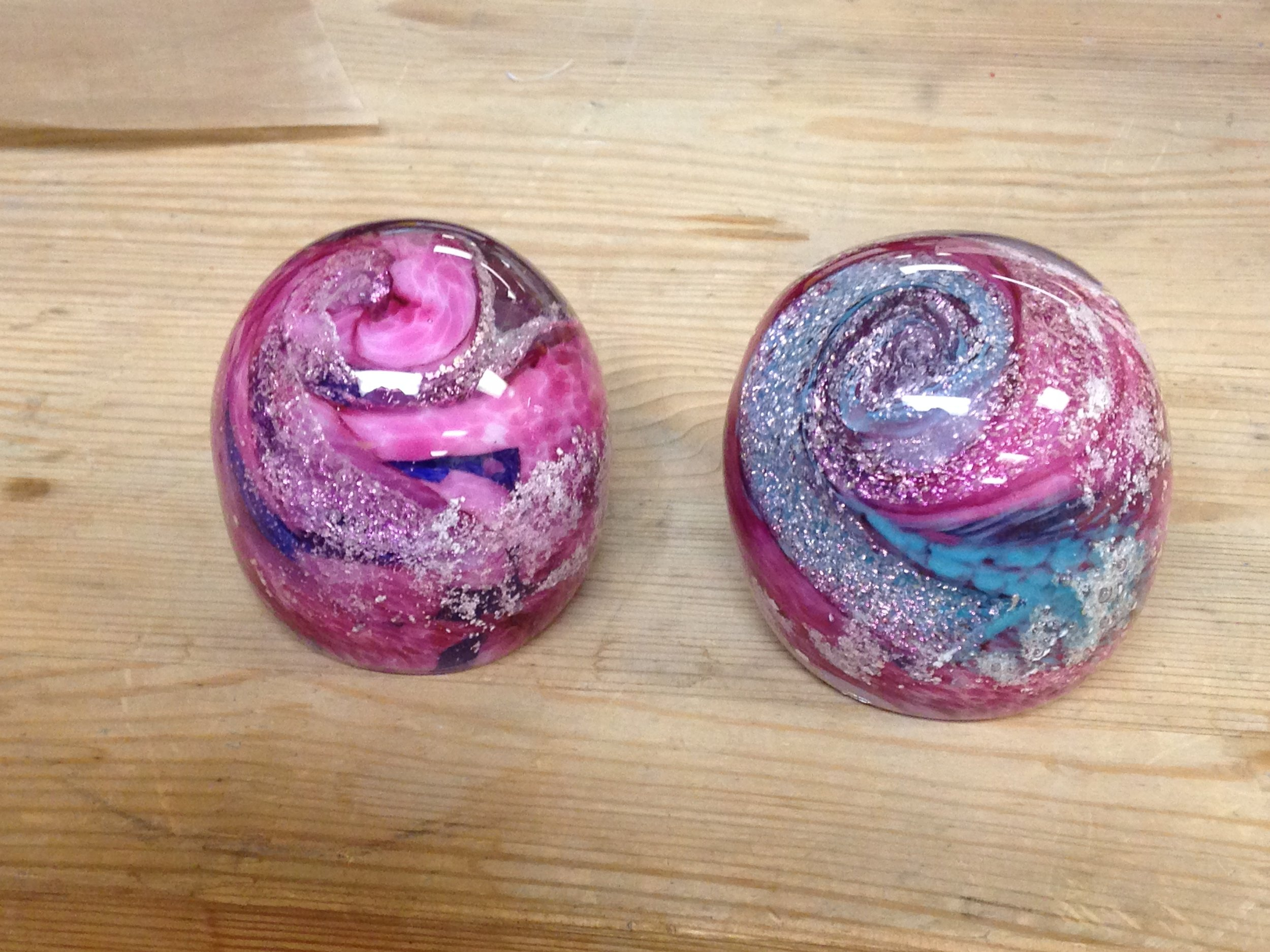 These are two paperweights for a customer. Each one has a little bit from all of her 5 dogs.