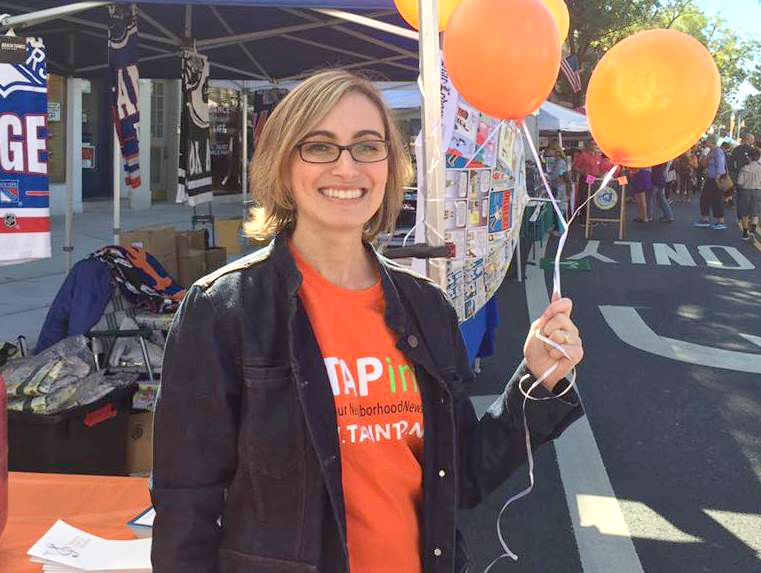 At the TAPinto booth at the Festifall Street Fair.