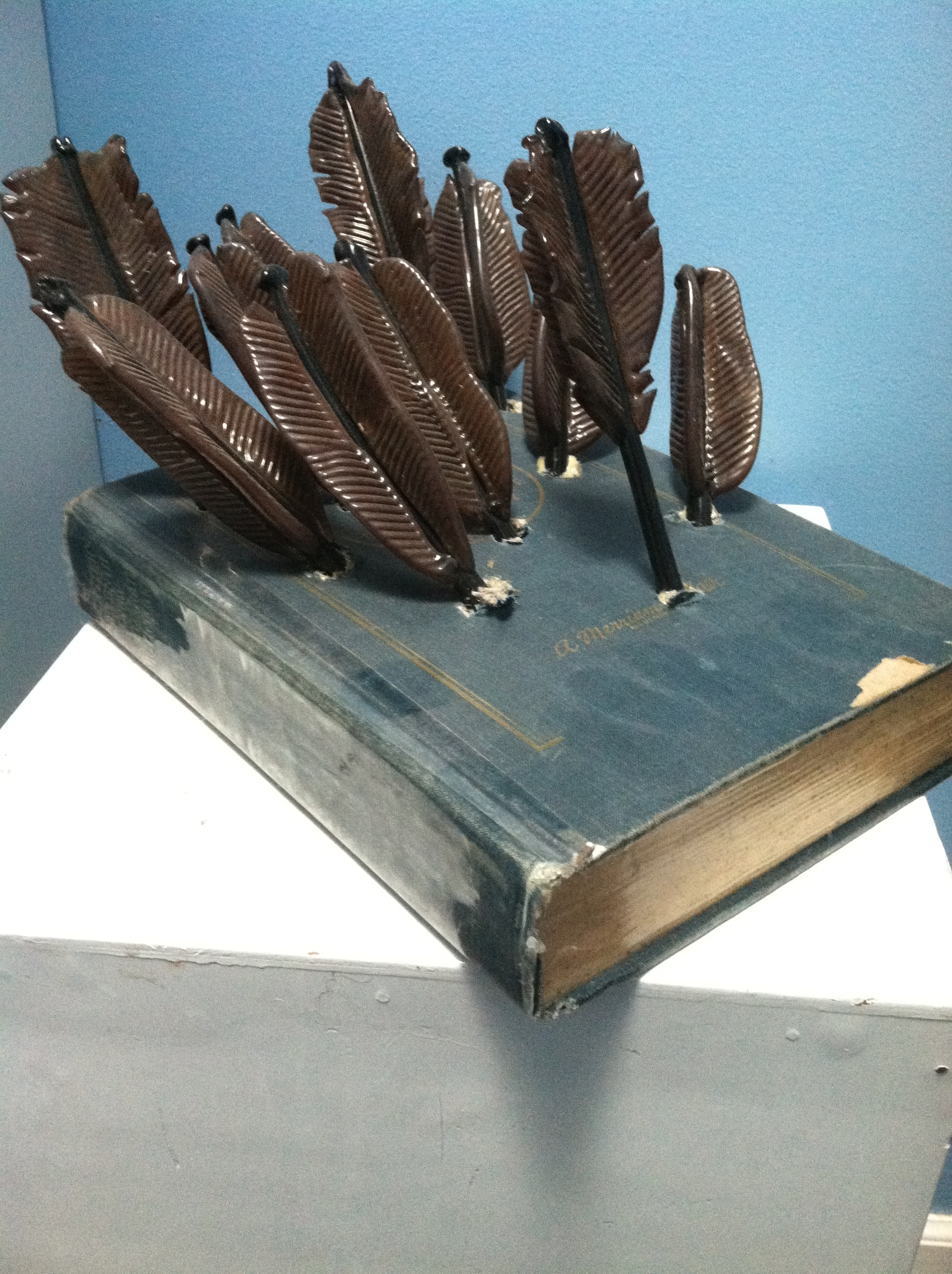 dictionary with glass arrows (history is told by the victors)
