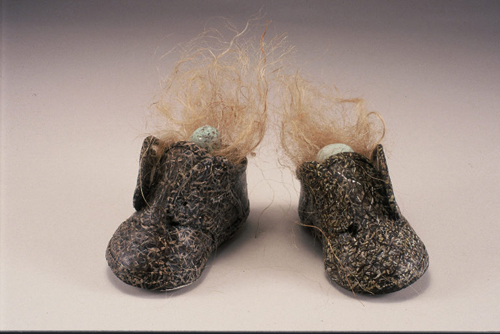 Jacqueline Bishop   Nestling , 2004 oil on leather baby shoes, twine and canary eggs