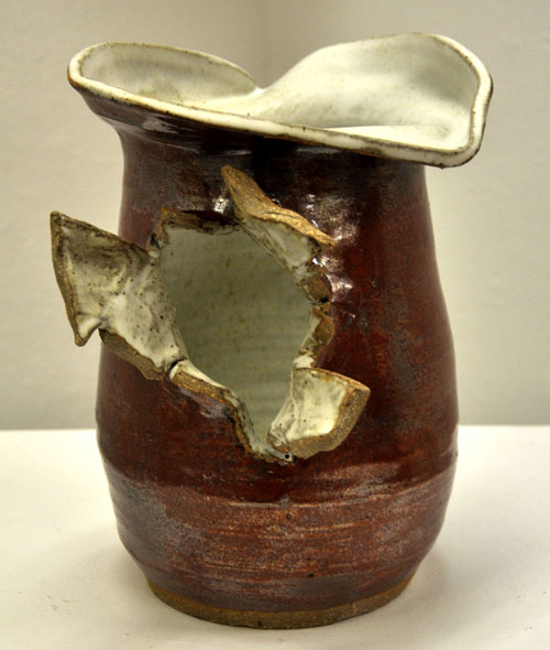 Bill Midkiff   Exploding Vase , 2011 mixed media  There exists a time honored tradition of ceramics artists producing both functional pottery and non-functional art. My interest in clay stems from the inherent limitations of the medium coinciding with the limitless possibilities the medium holds. These coexisting conflicting ideas shape my work. -Bill Midkiff