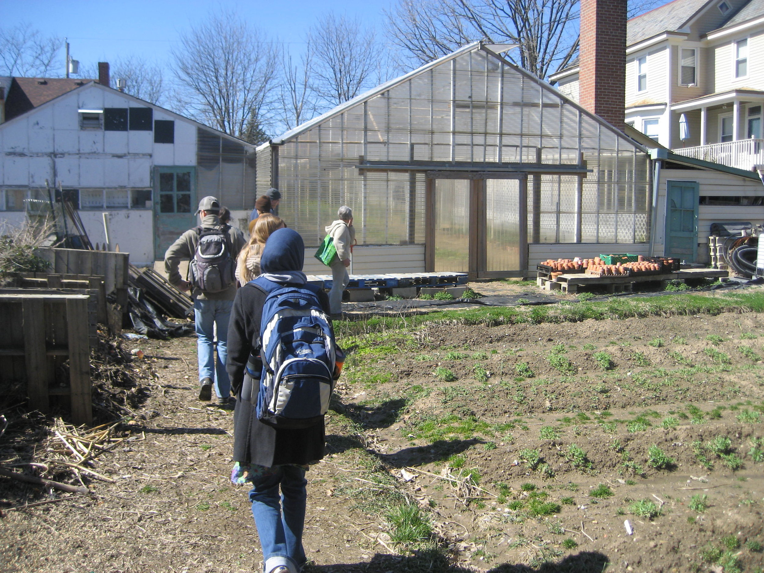 Students getting a tour of the Enright Ridge CSA Greenhouse
