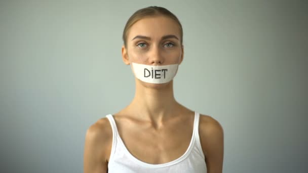 taped mouth diet girl.jpg