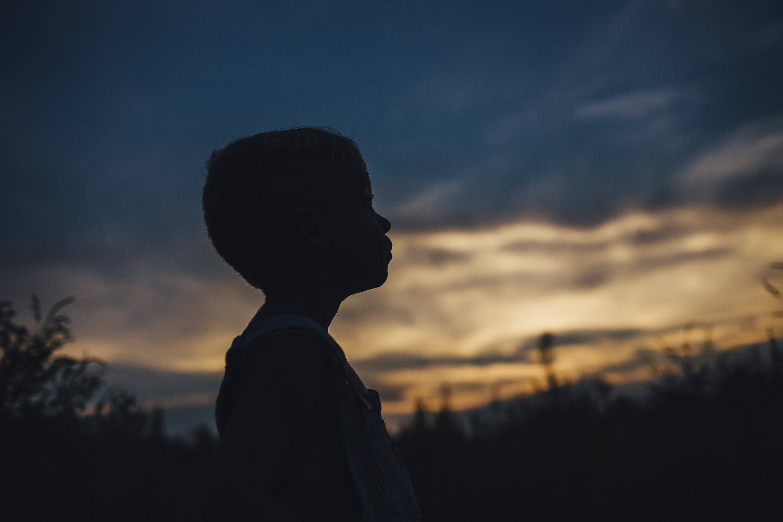 silhouette of boy with sunset