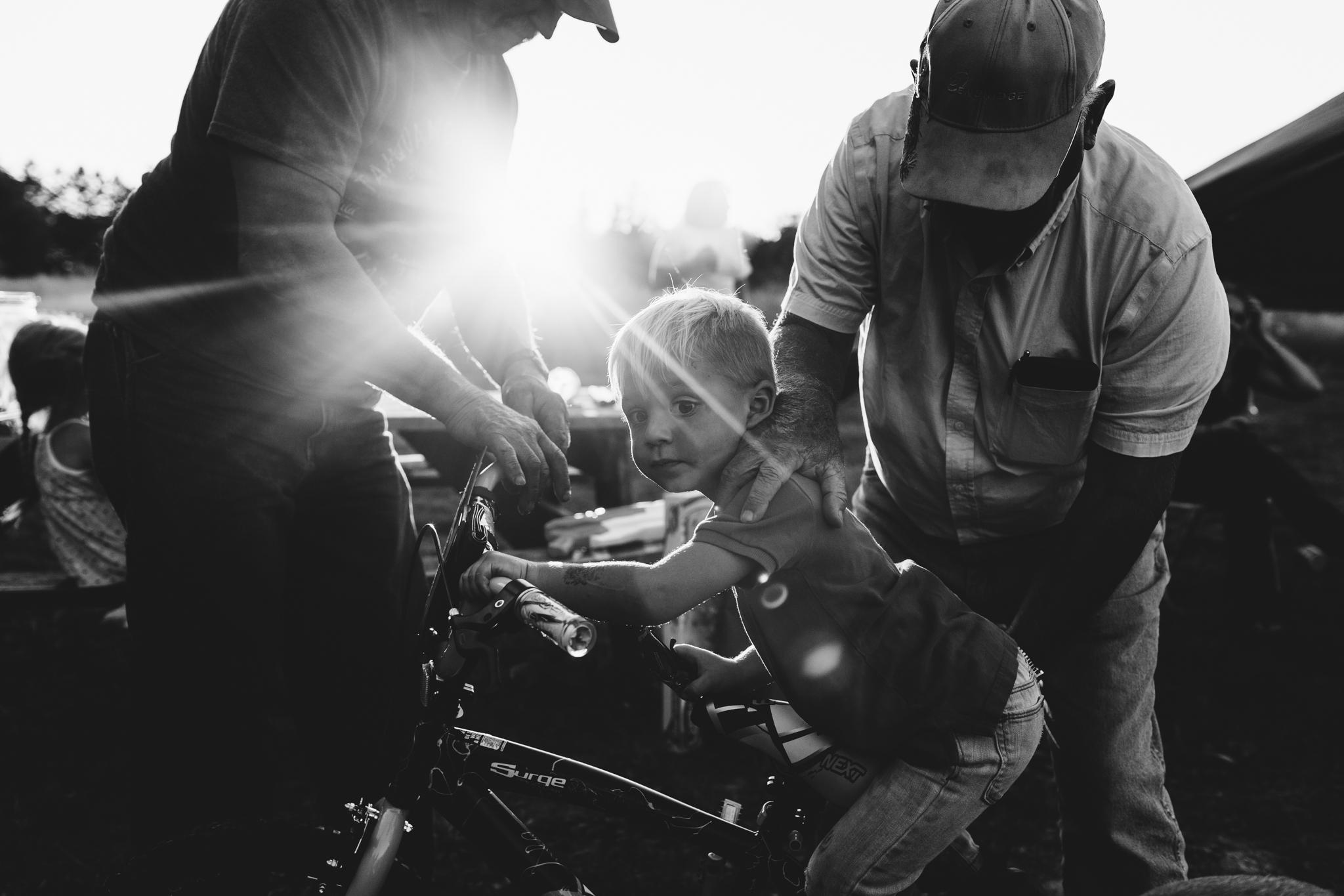 boy on bike with grandfathers