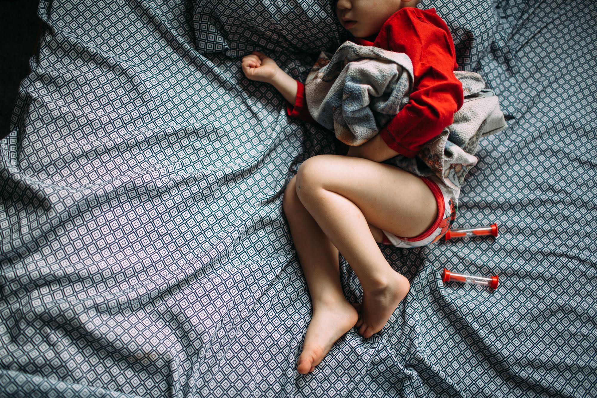 little boy sleeping in underwear