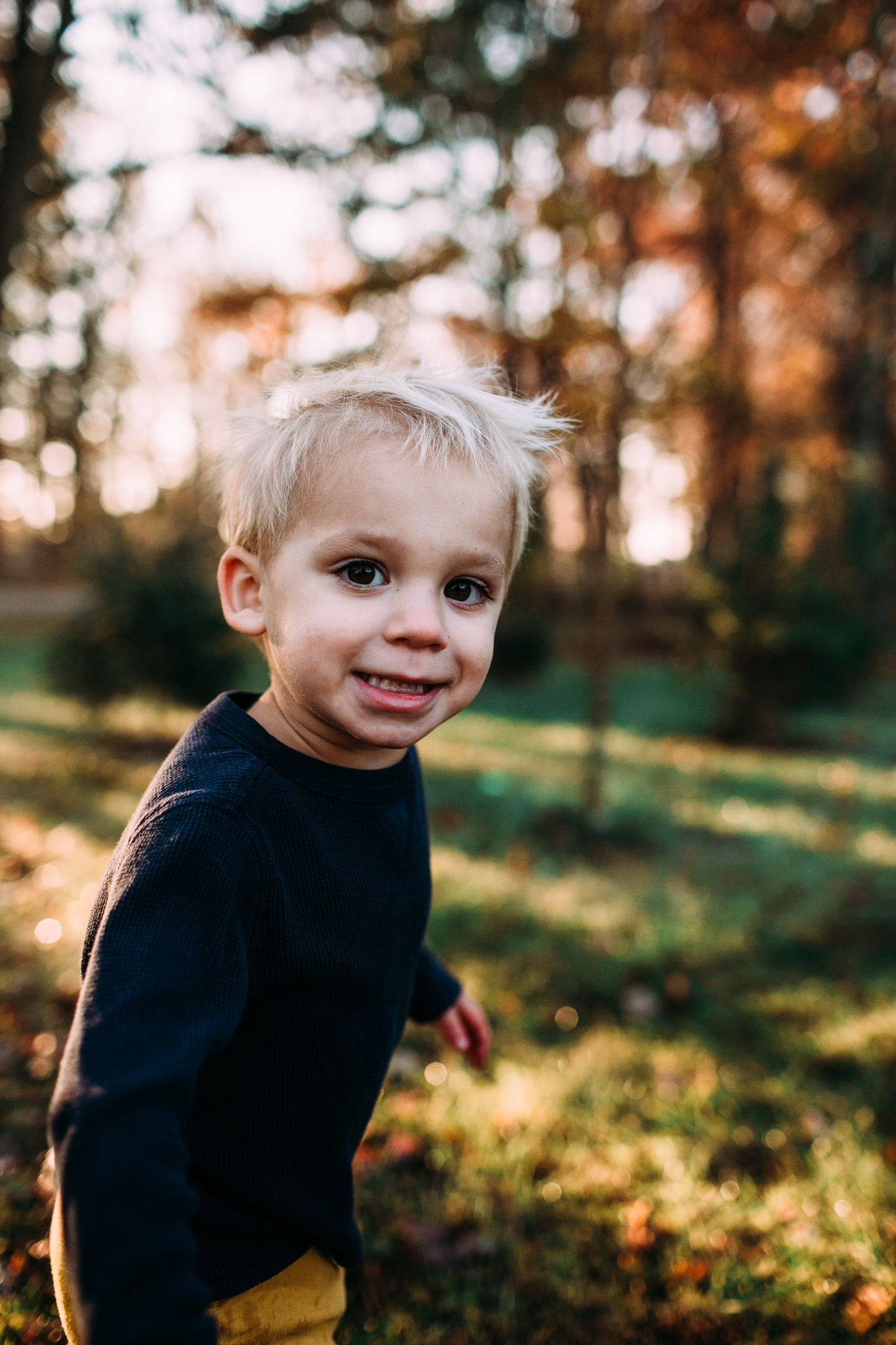young boy running in the fall color