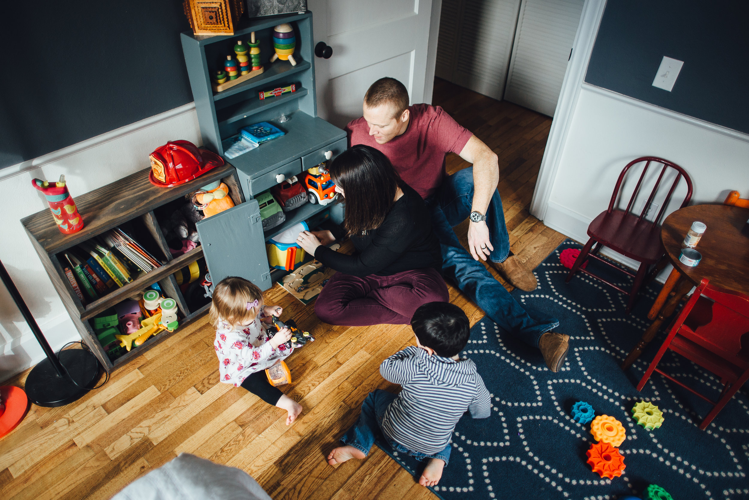 family in children's playroom