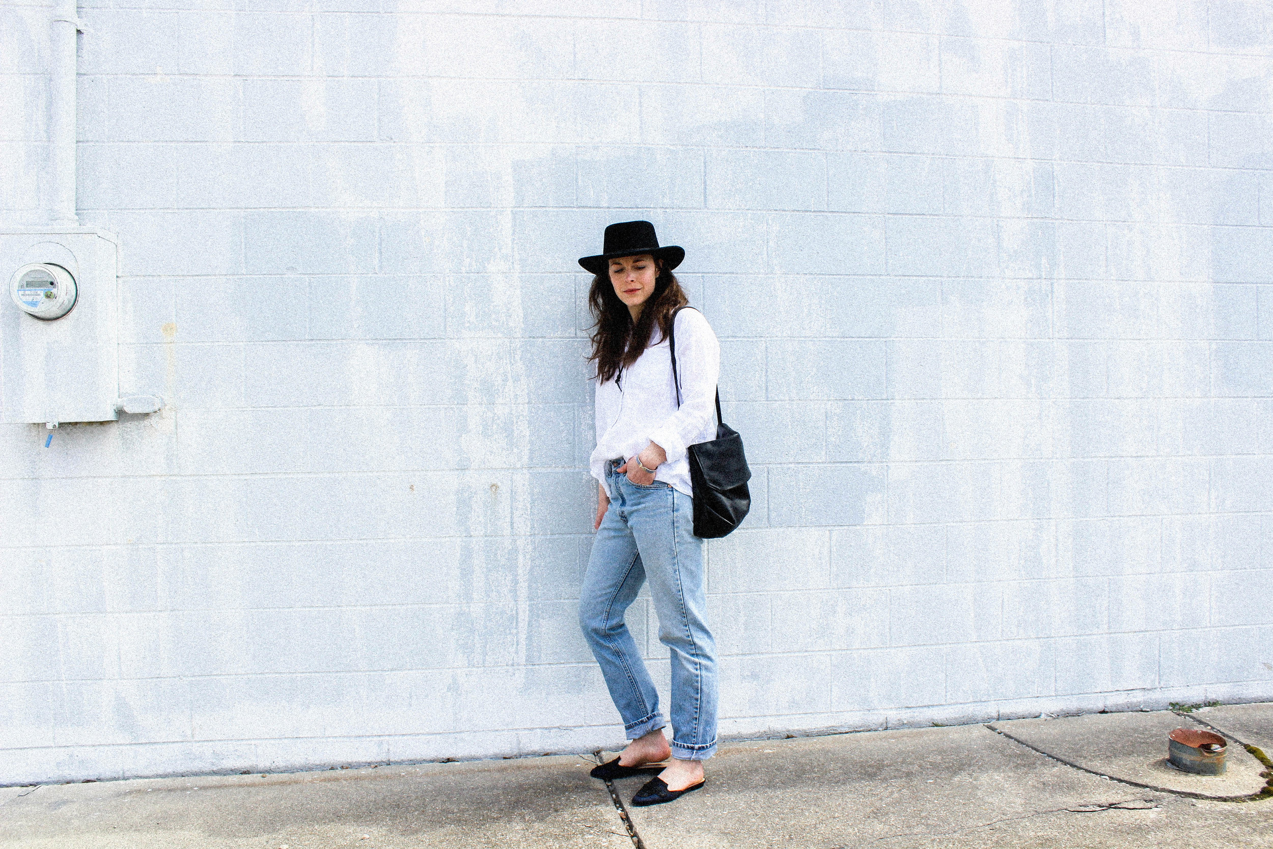 Wearing Tio y Tia Gambler Hat, Grana Linen Boyfriend Shirt, Thrifted Levi Jeans, Oscar De La Renta Spanish Mules, and Kristiina Taylor Frankie Shoulder Bag (coming soon).